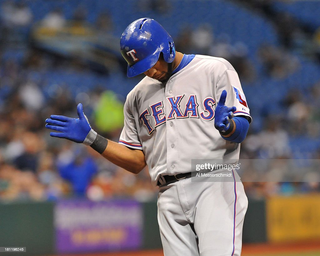 Infielder Elvis Andrus #1 of the Texas Rangers claps while corssing the plate after a third inning home run against the Tampa Bay Rays September 19, 2013 at Tropicana Field in St. Petersburg, Florida.