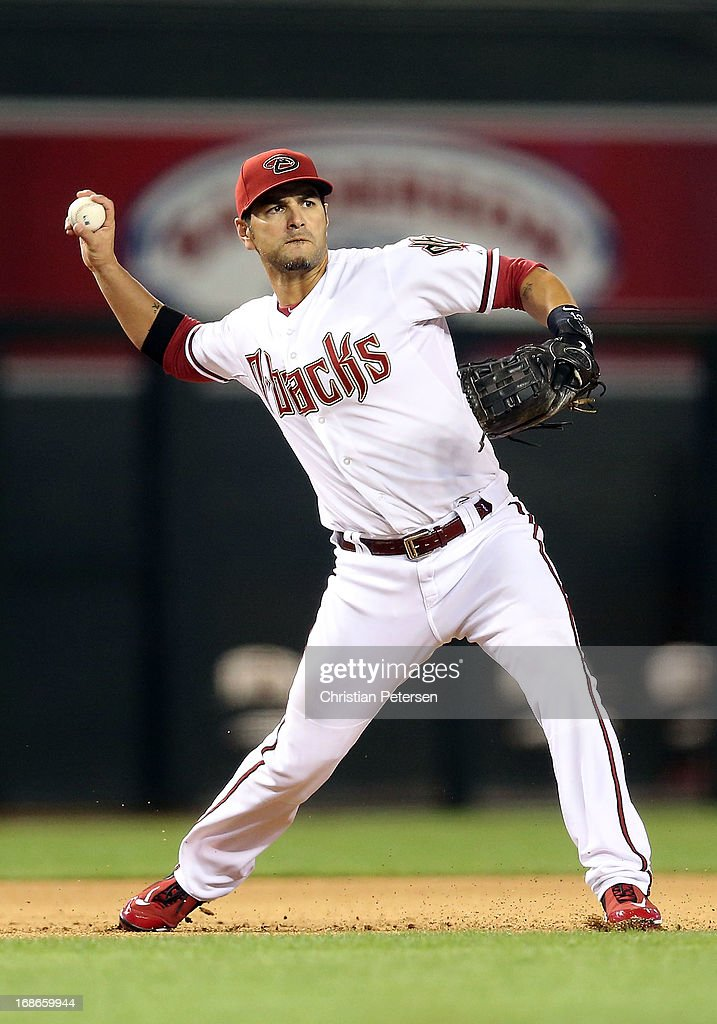 Infielder <a gi-track='captionPersonalityLinkClicked' href=/galleries/search?phrase=Eric+Chavez&family=editorial&specificpeople=201561 ng-click='$event.stopPropagation()'>Eric Chavez</a> #12 of the Arizona Diamondbacks fields a ground ball out against the Pittsburgh Pirates during the MLB game at Chase Field on April 9, 2013 in Phoenix, Arizona.