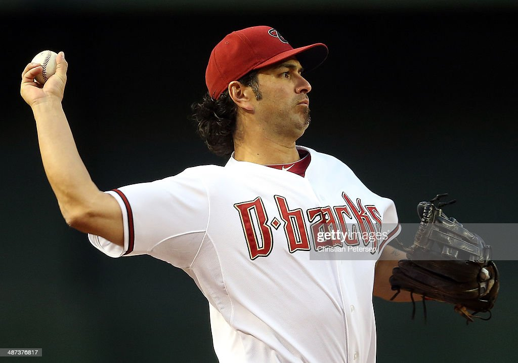 Infielder <a gi-track='captionPersonalityLinkClicked' href=/galleries/search?phrase=Eric+Chavez&family=editorial&specificpeople=201561 ng-click='$event.stopPropagation()'>Eric Chavez</a> #12 of the Arizona Diamondbacks fields a ground ball out against the Colorado Rockies during the MLB game at Chase Field on April 29, 2014 in Phoenix, Arizona.