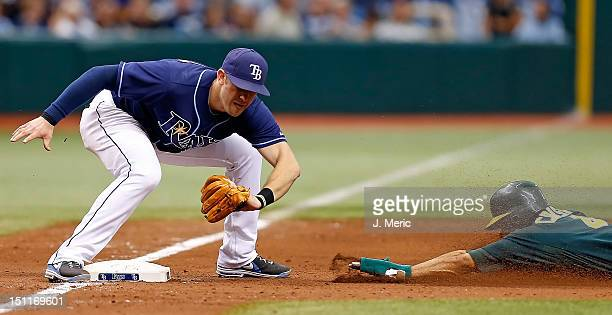 Infielder Evan Longoria of the Tampa Bay Rays applies the tag to Coco Crisp of the Oakland Athletics as he tried to steal third during the game at...