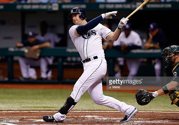 Infielder Evan Longoria of the Tampa Bay Rays bats against the Oakland Athletics during the game at Tropicana Field on August 24 2012 in St...