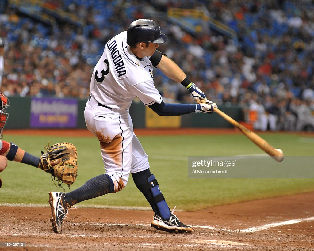 Infielder <a gi-track='captionPersonalityLinkClicked' href=/galleries/search?phrase=Evan+Longoria&family=editorial&specificpeople=2349329 ng-click='$event.stopPropagation()'>Evan Longoria</a> #3 of the Tampa Bay Rays bats in the 5th inning against the Boston Red Sox September 12, 2013 at Tropicana Field in St. Petersburg, Florida.