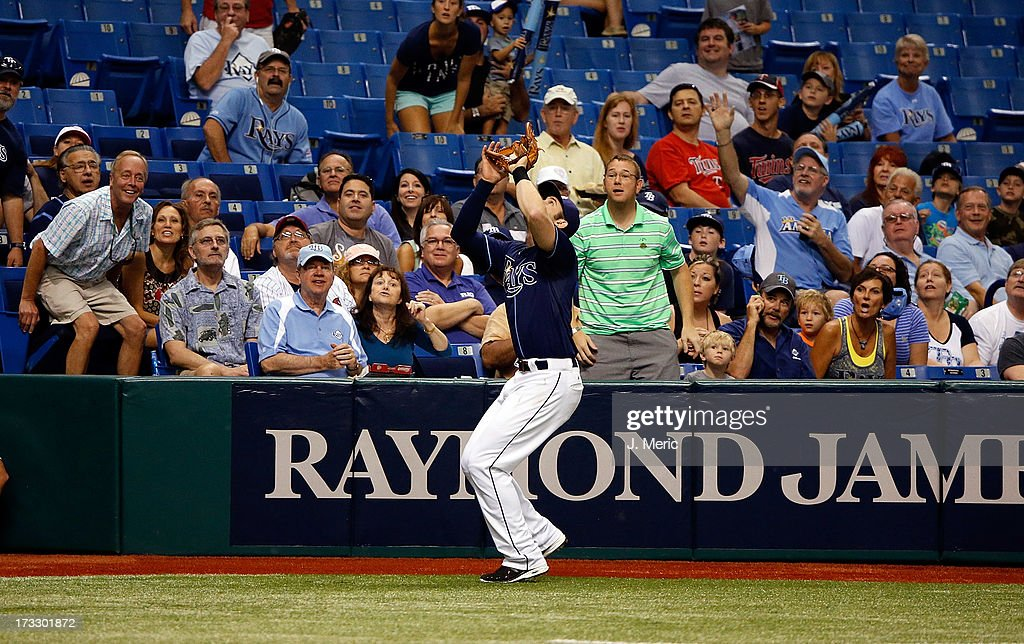 Infielder <a gi-track='captionPersonalityLinkClicked' href=/galleries/search?phrase=Evan+Longoria&family=editorial&specificpeople=2349329 ng-click='$event.stopPropagation()'>Evan Longoria</a> #3 of the Tampa Bay Rays catches a fly ball against the Minnesota Twins during the game at Tropicana Field on July 11, 2013 in St. Petersburg, Florida.