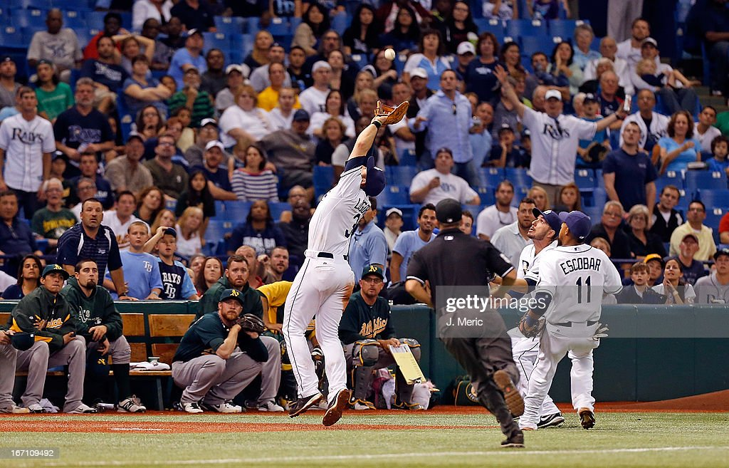Infielder <a gi-track='captionPersonalityLinkClicked' href=/galleries/search?phrase=Evan+Longoria&family=editorial&specificpeople=2349329 ng-click='$event.stopPropagation()'>Evan Longoria</a> #3 of the Tampa Bay Rays catches a foul ball in the ninth inning against the Oakland Athletics during the game at Tropicana Field on April 20, 2013 in St. Petersburg, Florida.
