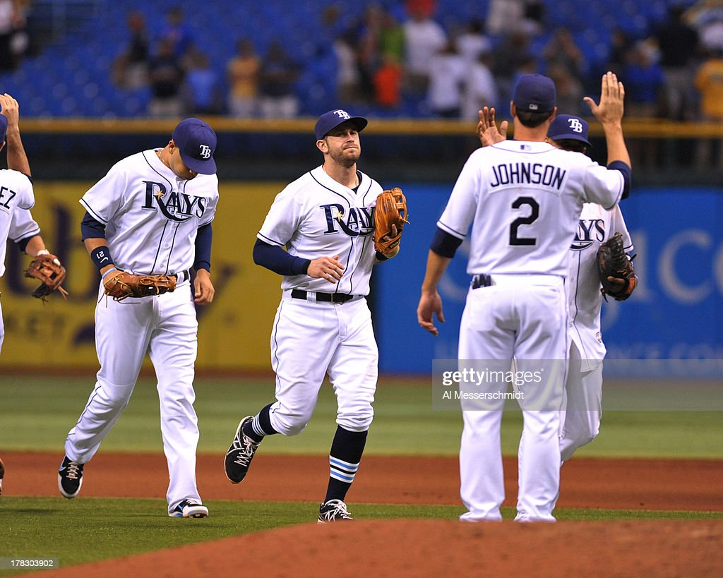 Infielder <a gi-track='captionPersonalityLinkClicked' href=/galleries/search?phrase=Evan+Longoria&family=editorial&specificpeople=2349329 ng-click='$event.stopPropagation()'>Evan Longoria</a> #3 of the Tampa Bay Rays celebrates after a 4 - 1 win against the Los Angeles Angels of Anaheim of Anaheim August 28, 2013 at Tropicana Field in St. Petersburg, Florida.
