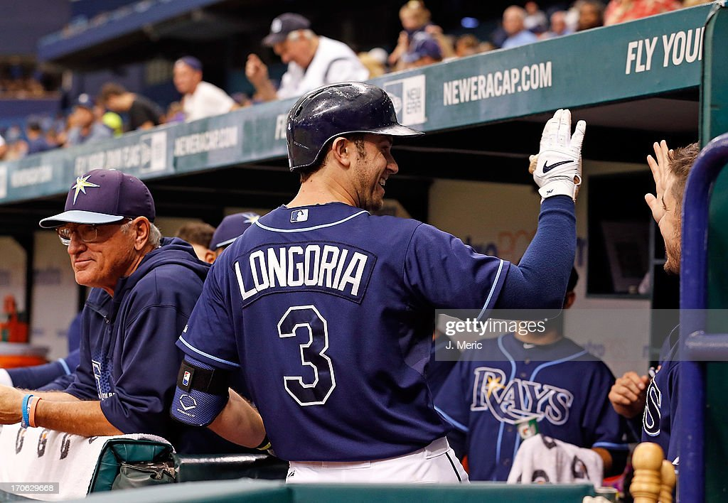 Infielder <a gi-track='captionPersonalityLinkClicked' href=/galleries/search?phrase=Evan+Longoria&family=editorial&specificpeople=2349329 ng-click='$event.stopPropagation()'>Evan Longoria</a> #3 of the Tampa Bay Rays celebrates his home run against the Kansas City Royals during the game at Tropicana Field on June 15, 2013 in St. Petersburg, Florida.