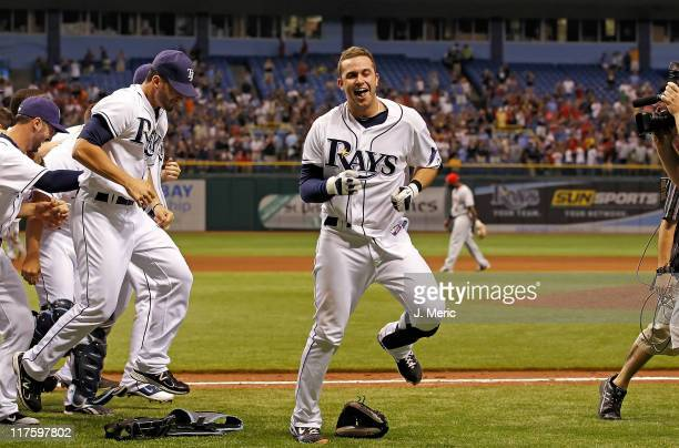 Infielder Evan Longoria of the Tampa Bay Rays celebrates his walk off home run against the Cincinnati Reds during the game at Tropicana Field on June...