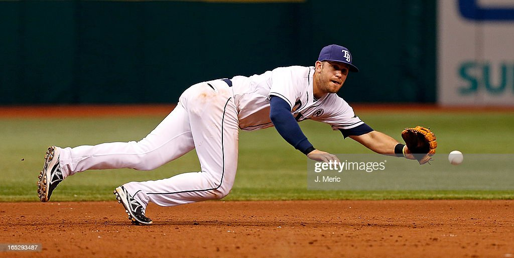 Infielder <a gi-track='captionPersonalityLinkClicked' href=/galleries/search?phrase=Evan+Longoria&family=editorial&specificpeople=2349329 ng-click='$event.stopPropagation()'>Evan Longoria</a> #3 of the Tampa Bay Rays fields this ground ball off the bat of catcher Matt Wieters #32 of the Baltimore Orioles during the Opening Day game at Tropicana Field on April 2, 2013 in St. Petersburg, Florida.