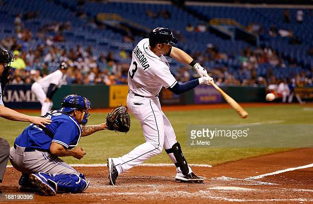 Infielder Evan Longoria of the Tampa Bay Rays hits a grand slam in the third inning against the Toronto Blue Jays during the game at Tropicana Field...
