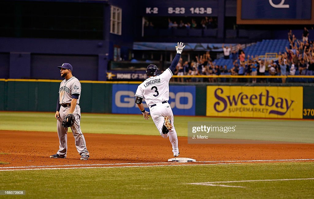 Infielder <a gi-track='captionPersonalityLinkClicked' href=/galleries/search?phrase=Evan+Longoria&family=editorial&specificpeople=2349329 ng-click='$event.stopPropagation()'>Evan Longoria</a> #3 of the Tampa Bay Rays hits a two run home run to win the game against the San Diego Padres at Tropicana Field on May 11, 2013 in St. Petersburg, Florida.