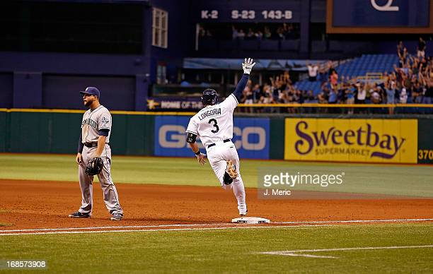 Infielder Evan Longoria of the Tampa Bay Rays hits a two run home run to win the game against the San Diego Padres at Tropicana Field on May 11 2013...