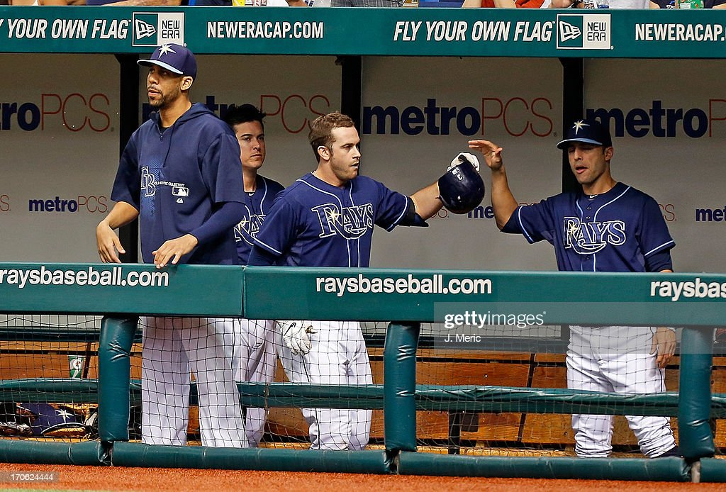 Infielder Evan Longoria #3 of the Tampa Bay Rays is congratulated after his sacrifice fly against the Kansas City Royals during the game at Tropicana Field on June 15, 2013 in St. Petersburg, Florida.