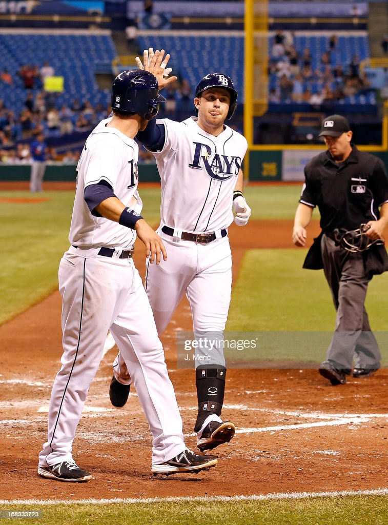 Infielder <a gi-track='captionPersonalityLinkClicked' href=/galleries/search?phrase=Evan+Longoria&family=editorial&specificpeople=2349329 ng-click='$event.stopPropagation()'>Evan Longoria</a> #3 of the Tampa Bay Rays is congratulated by <a gi-track='captionPersonalityLinkClicked' href=/galleries/search?phrase=Ben+Zobrist&family=editorial&specificpeople=2120037 ng-click='$event.stopPropagation()'>Ben Zobrist</a> #18 after his two run home run against the Toronto Blue Jays during the game at Tropicana Field on May 8, 2013 in St. Petersburg, Florida.