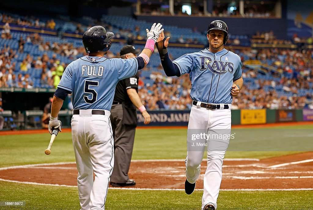 Infielder <a gi-track='captionPersonalityLinkClicked' href=/galleries/search?phrase=Evan+Longoria&family=editorial&specificpeople=2349329 ng-click='$event.stopPropagation()'>Evan Longoria</a> #3 of the Tampa Bay Rays is congratulated by <a gi-track='captionPersonalityLinkClicked' href=/galleries/search?phrase=Sam+Fuld&family=editorial&specificpeople=4505687 ng-click='$event.stopPropagation()'>Sam Fuld</a> #5 after scoring against the San Diego Padres during the game at Tropicana Field on May 12, 2013 in St. Petersburg, Florida.