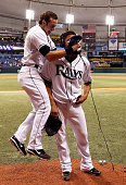 Infielder Evan Longoria of the Tampa Bay Rays puts shaving cream in the face of pitcher Matt Garza as he is interviewed after his no hitter against...
