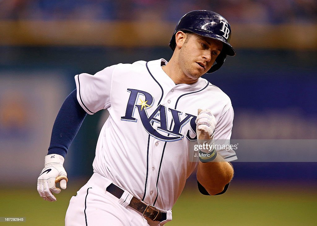 Infielder <a gi-track='captionPersonalityLinkClicked' href=/galleries/search?phrase=Evan+Longoria&family=editorial&specificpeople=2349329 ng-click='$event.stopPropagation()'>Evan Longoria</a> #3 of the Tampa Bay Rays rounds the bases after his ninth inning home run against the New York Yankees during the game at Tropicana Field on April 23, 2013 in St. Petersburg, Florida.
