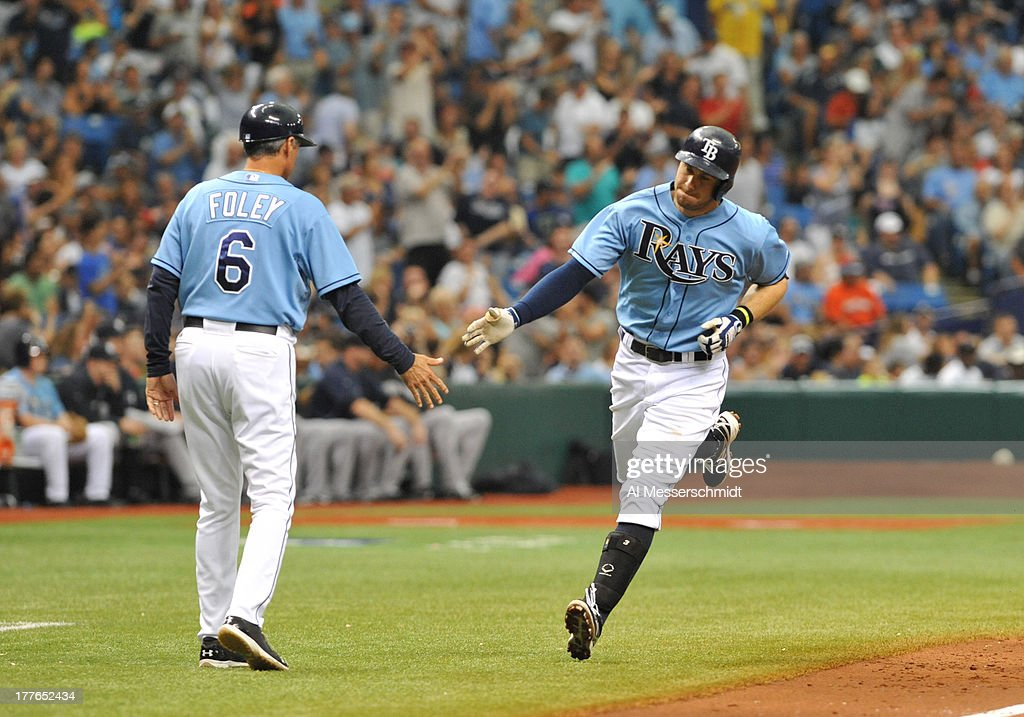 Infielder <a gi-track='captionPersonalityLinkClicked' href=/galleries/search?phrase=Evan+Longoria&family=editorial&specificpeople=2349329 ng-click='$event.stopPropagation()'>Evan Longoria</a> #3 of the Tampa Bay Rays rounds third base after a home run against the New York Yankees August 25, 2013 at Tropicana Field in St. Petersburg, Florida.