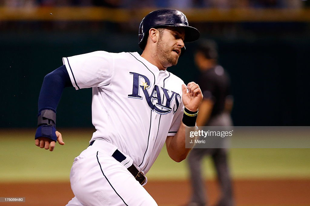 Infielder <a gi-track='captionPersonalityLinkClicked' href=/galleries/search?phrase=Evan+Longoria&family=editorial&specificpeople=2349329 ng-click='$event.stopPropagation()'>Evan Longoria</a> #3 of the Tampa Bay Rays rounds third base on his way home against the Arizona Diamondbacks during the first inning at Tropicana Field on July 30, 2013 in St. Petersburg, Florida.