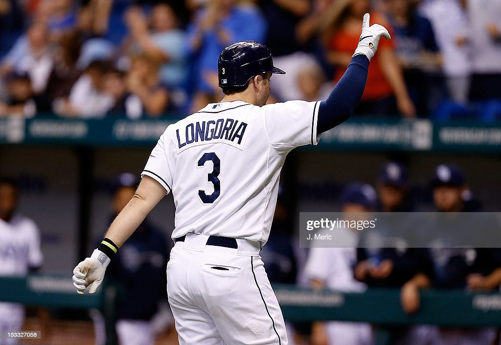Infielder <a gi-track='captionPersonalityLinkClicked' href=/galleries/search?phrase=Evan+Longoria&family=editorial&specificpeople=2349329 ng-click='$event.stopPropagation()'>Evan Longoria</a> #3 of the Tampa Bay Rays salutes the crowd after after hitting a home run against the Baltimore Orioles during the game at Tropicana Field on October 3, 2012 in St. Petersburg, Florida.