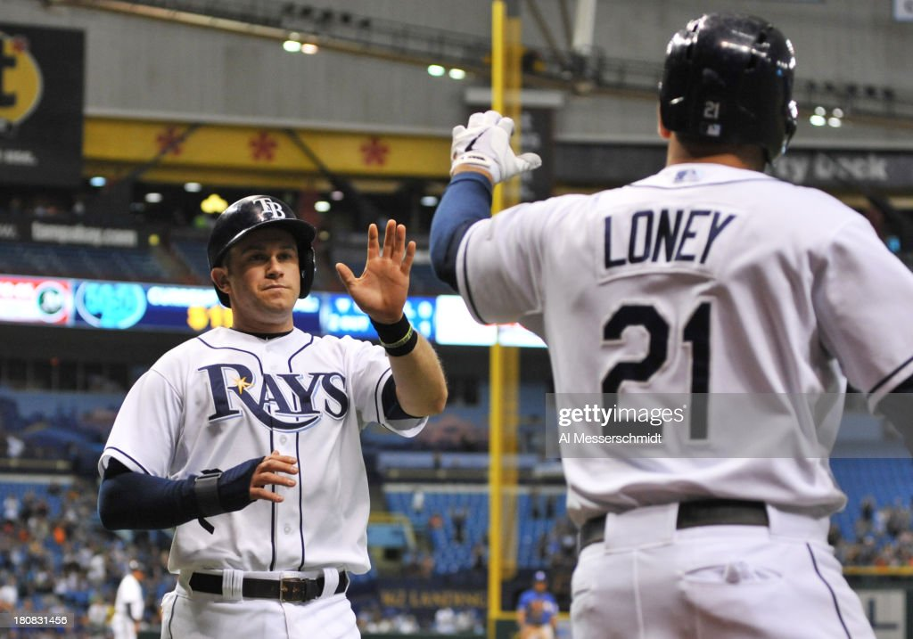 Infielder <a gi-track='captionPersonalityLinkClicked' href=/galleries/search?phrase=Evan+Longoria&family=editorial&specificpeople=2349329 ng-click='$event.stopPropagation()'>Evan Longoria</a> #3 of the Tampa Bay Rays scores against the Texas Rangers September 16, 2013 at Tropicana Field in St. Petersburg, Florida. The Rays won 6 - 2.