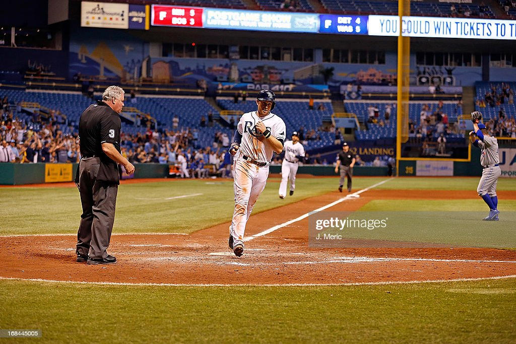 Infielder Evan Longoria #3 of the Tampa Bay Rays scores the winning run in the tenth inning on a walk against the Toronto Blue Jays at Tropicana Field on May 9, 2013 in St. Petersburg, Florida.