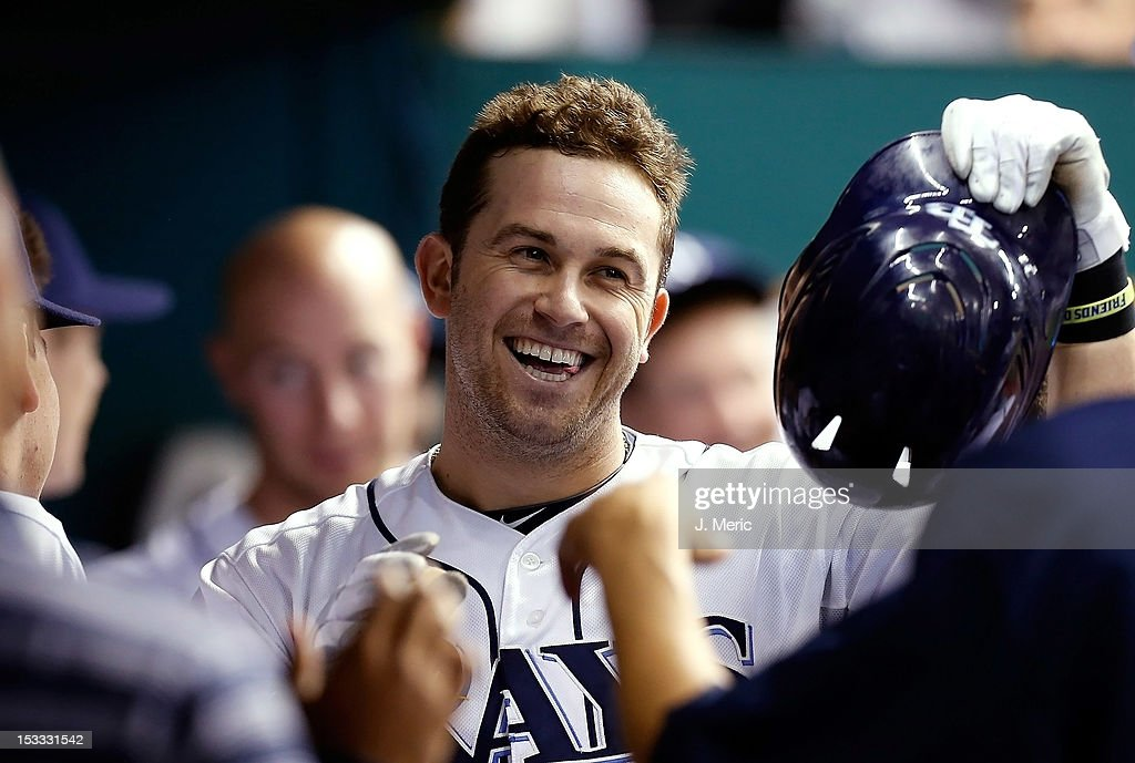 Infielder <a gi-track='captionPersonalityLinkClicked' href=/galleries/search?phrase=Evan+Longoria&family=editorial&specificpeople=2349329 ng-click='$event.stopPropagation()'>Evan Longoria</a> #3 of the Tampa Bay Rays smiles after his third home run of the night against the Baltimore Orioles during the game at Tropicana Field on October 3, 2012 in St. Petersburg, Florida.