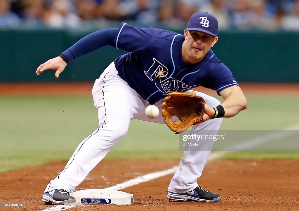 Infielder <a gi-track='captionPersonalityLinkClicked' href=/galleries/search?phrase=Evan+Longoria&family=editorial&specificpeople=2349329 ng-click='$event.stopPropagation()'>Evan Longoria</a> #3 of the Tampa Bay Rays takes the throw at third against the Oakland Athletics during the game at Tropicana Field on August 25, 2012 in St. Petersburg, Florida.