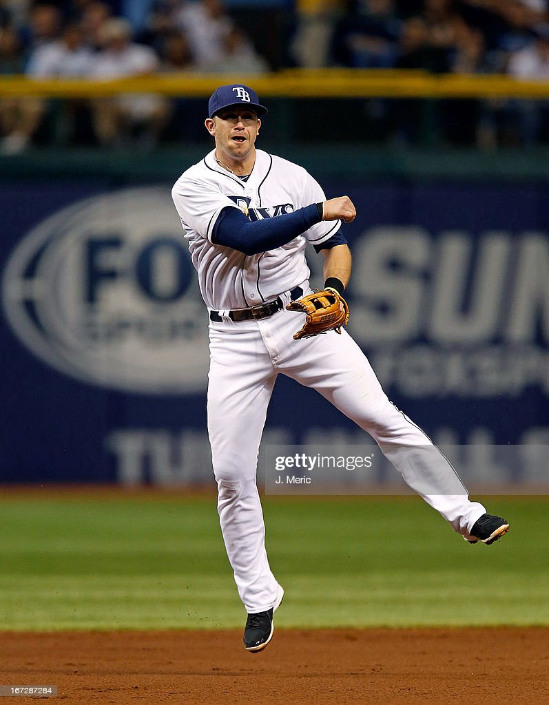 Infielder <a gi-track='captionPersonalityLinkClicked' href=/galleries/search?phrase=Evan+Longoria&family=editorial&specificpeople=2349329 ng-click='$event.stopPropagation()'>Evan Longoria</a> #3 of the Tampa Bay Rays throws over to first for an out against the New York Yankees during the game at Tropicana Field on April 23, 2013 in St. Petersburg, Florida.