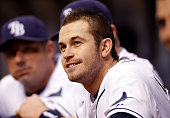 Infielder Evan Longoria of the Tampa Bay Rays watches his team from the dugout against the Toronto Blue Jays during the game at Tropicana Field on...