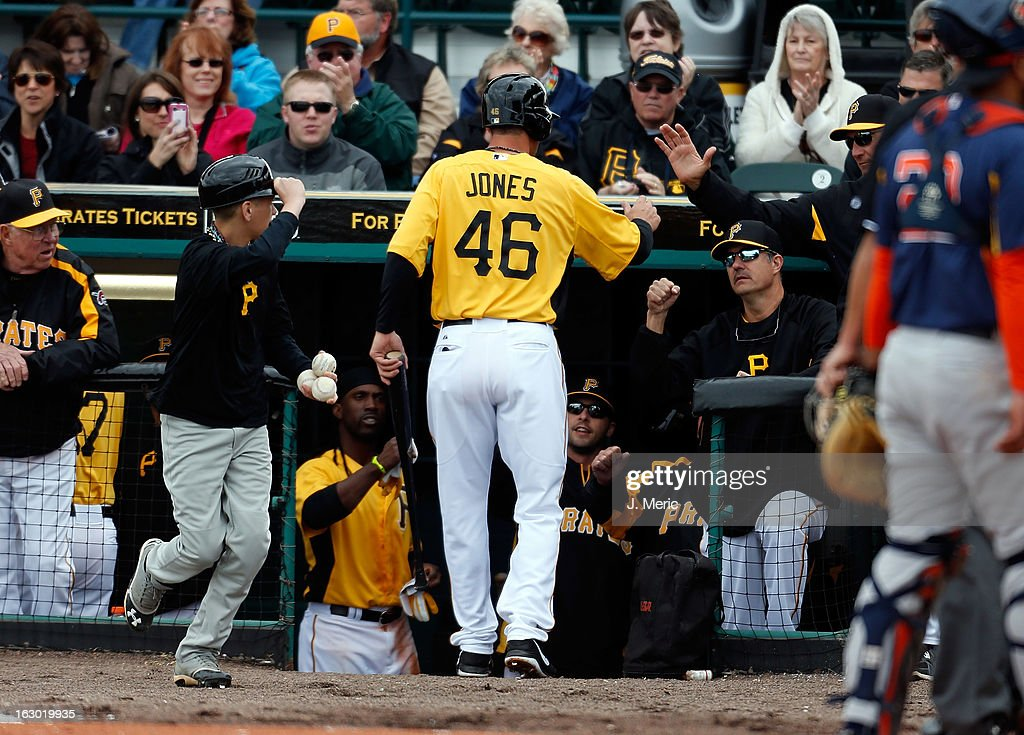 Infielder <a gi-track='captionPersonalityLinkClicked' href=/galleries/search?phrase=Garrett+Jones&family=editorial&specificpeople=835861 ng-click='$event.stopPropagation()'>Garrett Jones</a> #46 of the Pittsburgh Pirates is congratulated after scoring a run against the Houston Astros during a Grapefruit League Spring Training Game at McKechnie Field on March 3, 2013 in Bradenton, Florida.