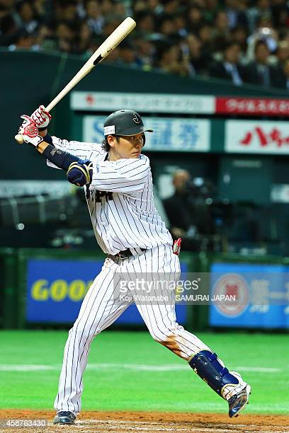 Infielder Hayato Sakamoto bats during the friendly match between Samurai Japan and Fukuoka SoftBank Hawks Hokkaido Nipponham Fighters at Fukuoka...