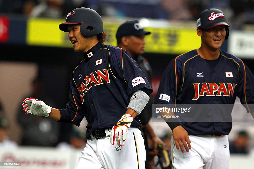 Infielder Hayato Sakamoto #6 of Japan celebrate after the international friendly game between Australia and Japan at Kyocera Dome Osaka on February 24, 2013 in Osaka, Japan.