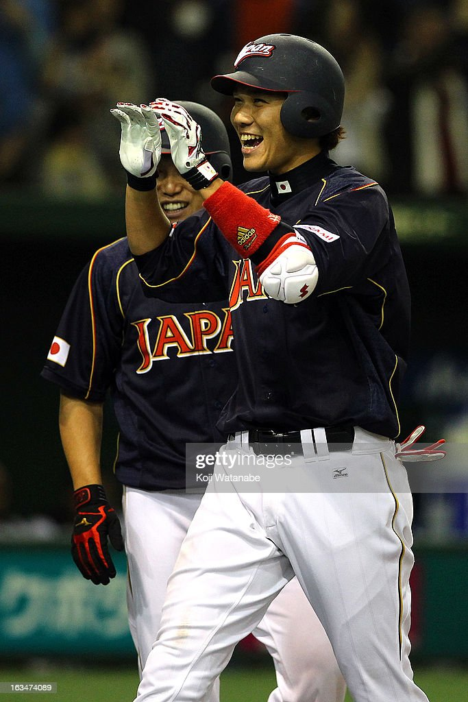 Infielder Hayato Sakamoto #6 of Japan celebrates after scoring a grand slam homer in the top of the seventh inning during the World Baseball Classic Second Round Pool 1 game between Japan and the Netherlands at Tokyo Dome on March 10, 2013 in Tokyo, Japan.