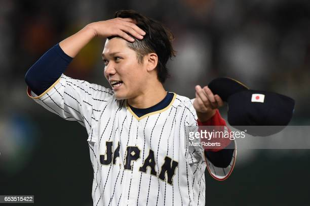 Infielder Hayato Sakamoto of Japan celebrates after the World Baseball Classic Pool E Game Six between Israel and Japan at the Tokyo Dome on March 15...