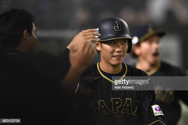 Infielder Hayato Sakamoto of Japan celebrates with team mates after scoring a run by a RBI single of Catcher Seiji Kobayashi in the top of the fifth...