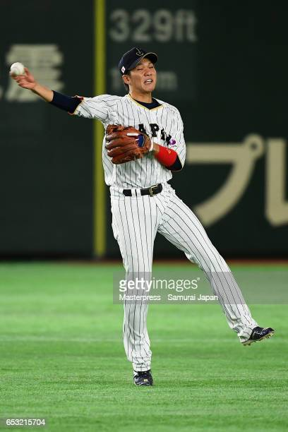 Infielder Hayato Sakamoto of Japan fields a grounder by Outfielder Roel Santos of Cuba in the top of the seventh inning during the World Baseball...