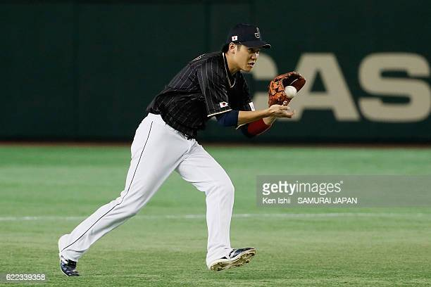 Infielder Hayato Sakamoto of Japan fields in the third inning during the international friendly match between Mexico and Japan at the Tokyo Dome on...