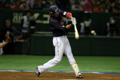 Infielder Hayato Sakamoto of Japan hit a grand slam homer in the top half of the seventh inning during the World Baseball Classic Second Round Pool 1...