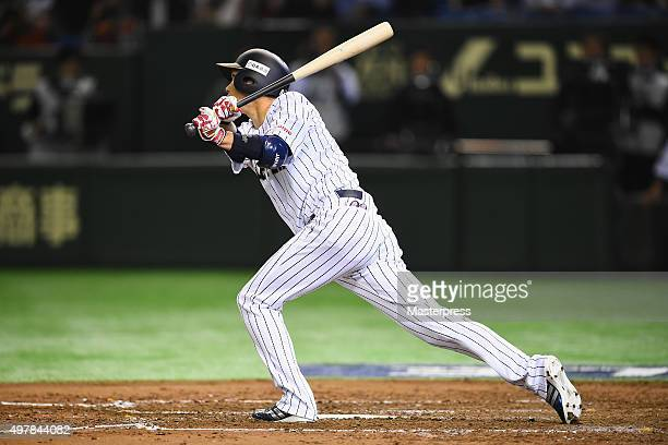 Infielder Hayato Sakamoto of Japan hits a sacrifice fly to make 30 in the bottom of fourth inning during the WBSC Premier 12 semi final match between...