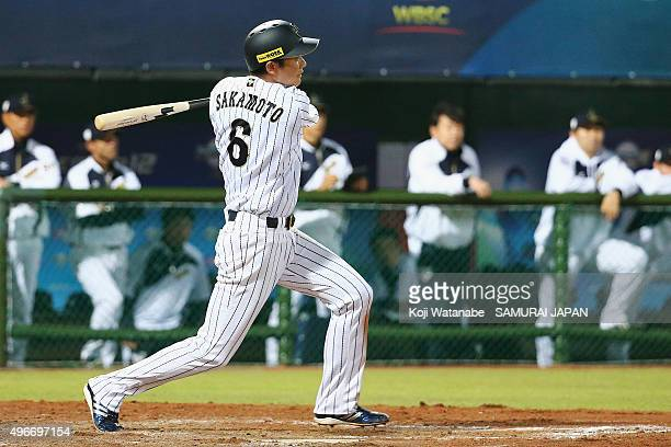 Infielder Hayato Sakamoto of Japan hits a single in the bottom of the fifth inning during the WBSC Premier 12 match between Mexico and Japan at the...