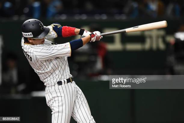 Infielder Hayato Sakamoto of Japan hits a sinle in the bottom of the seventh inning during the World Baseball Classic Pool E Game Six between Israel...