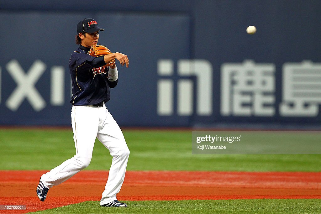 Infielder Hayato Sakamoto #6 of Japan in action during the friendly game between Hanshin Tigers and Japan at Kyocera Dome Osaka on February 26, 2013 in Osaka, Japan.