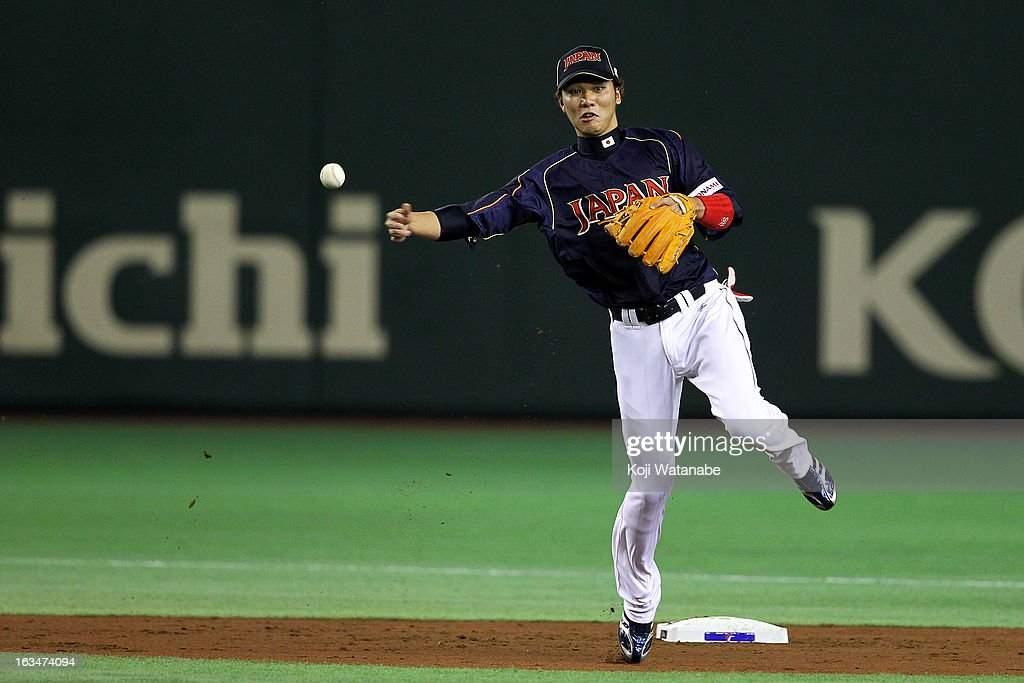 Infielder <a gi-track='captionPersonalityLinkClicked' href=/galleries/search?phrase=Hayato+Sakamoto&family=editorial&specificpeople=4467172 ng-click='$event.stopPropagation()'>Hayato Sakamoto</a> #6 of Japan in action during the World Baseball Classic Second Round Pool 1 game between Japan and the Netherlands at Tokyo Dome on March 10, 2013 in Tokyo, Japan.