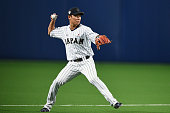 Infielder Hayato Sakamoto of Japan prepares prior to the top of fifth inning during the international friendly match between Japan and Chinese Taipei...