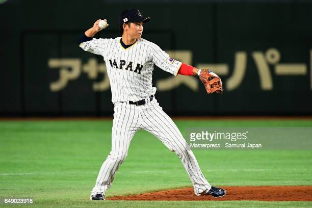 Infielder Hayato Sakamoto of Japan throws after fiedling a grounder by Catcher Frank Morejon of Cuba in the top of the second inning during the World...