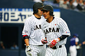 Infielder Hayato Sakamoto of Samurai Japan celerates after scoring in the top of the second inning the game one of Samurai Japan and MLB All Stars at...