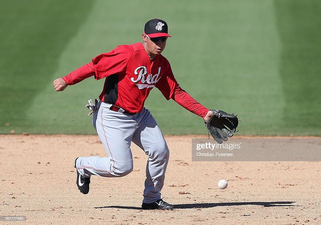 Infielder Henry Rodriguez #36 of the Cincinnati Reds attempts to field a ground ball during the spring training game against the San Diego Padres at Peoria Stadium on February 26, 2013 in Peoria, Arizona.