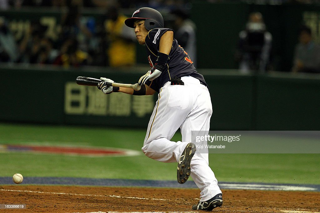 Infielder <a gi-track='captionPersonalityLinkClicked' href=/galleries/search?phrase=Hirokazu+Ibata&family=editorial&specificpeople=2922541 ng-click='$event.stopPropagation()'>Hirokazu Ibata</a> #3 of Japan bants during the World Baseball Classic Second Round Pool 1 game between Japan and Chinese Taipei at Tokyo Dome on March 8, 2013 in Tokyo, Japan.