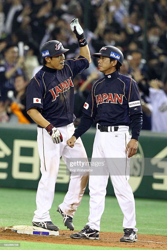 Infielder <a gi-track='captionPersonalityLinkClicked' href=/galleries/search?phrase=Hirokazu+Ibata&family=editorial&specificpeople=2922541 ng-click='$event.stopPropagation()'>Hirokazu Ibata</a> #3 of Japan celebrates hitting a RBI single in the top half of the ninth inning during the World Baseball Classic Second Round Pool 1 game between Japan and Chinese Taipei at Tokyo Dome on March 8, 2013 in Tokyo, Japan.