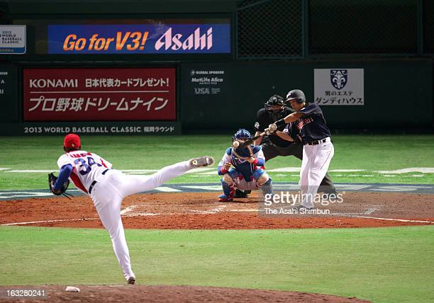 Infielder Hirokazu Ibata of Japan hits a RBI single at the top of ninth inning during the World Baseball Classic First Round Group A game between...